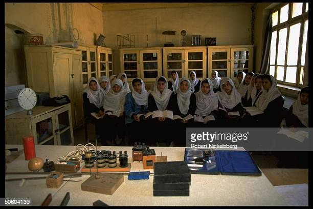 Govt girl's high school class in science re threat of closure by Islamic Taliban civil war faction nring city opposing education for women