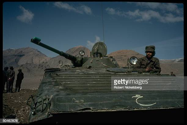 Govt. Troops manning tank, prob. Fr. 3rd Div. Of Interior Ministry Sarandoy Police, at security post at 2nd of 3 def. Perimeters surrounding Kabul,...