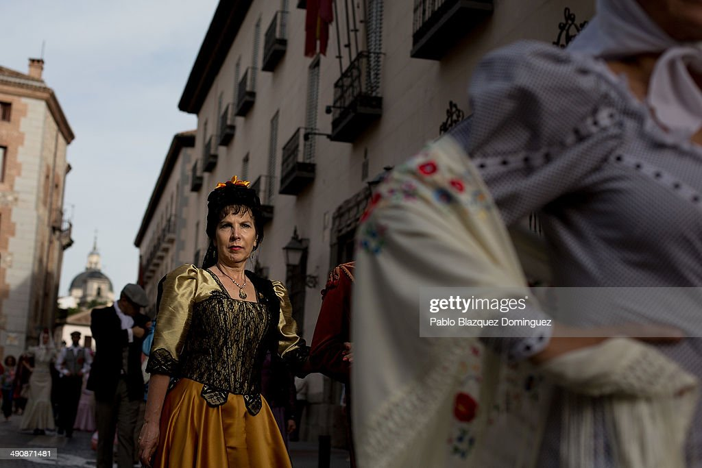 'Goyescas' take part in the San Isidro procession during the San Isidro festivities on May 15, 2014 in Madrid, Spain. During the festivities in honor of San Isidro Labrador in Madrid revelers take the streets and enjoy music and popular food. Chulapos or Goyescos dance the regional dance known as 'chotis' wearing traditional costumes of Madrid.