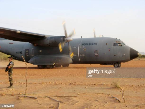 A French Airforce transport plane loaded with humanitarian aid taxis at an airstrip just outside Goz Beida which is 90 kilometres from the Sudanese...