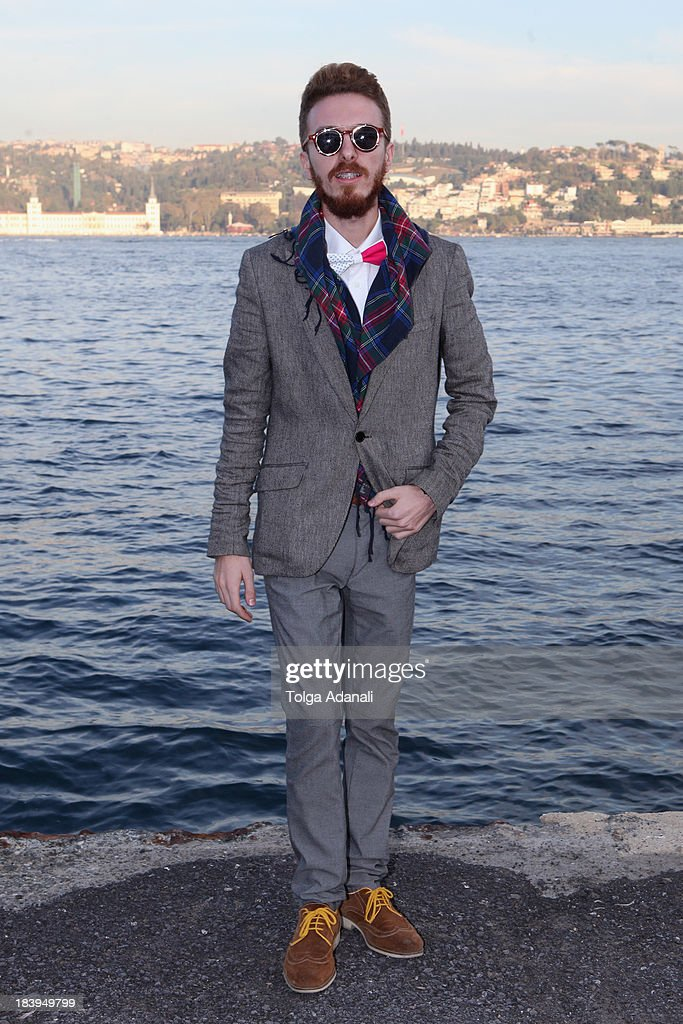 Goze Sener wears Zara pants, H&M jacket and Vakko shirt during Mercedes-Benz Fashion Week Istanbul s/s 2014 presented by American Express on October 10, 2013 in Istanbul, Turkey.