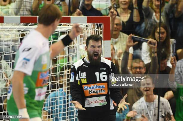 Göppingen's goalkeeper Primoz Prost reacts after stopping a ball during the EHFCup handball final match between Berlin Füchse and Frisch Auf...