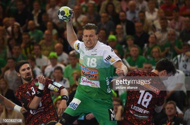 Göppingen's Lars Kaufmann in action with Berlin's Fabian Wiede and Berlin's Hans Lindberg during the EHFCup handball final match between Berlin...