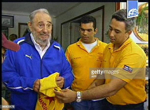 TV grab from a video shot on August 22 2009 and released by the Cuban TV on August 23 2009 in Havana of Cuban leader Fidel Castro and Venezuelan Law...