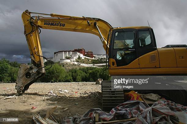A grab parks at a construction site behind the Potala Palace on June 27 2006 in Lhasa Tibetan Autonomous Region China The Chinese economy is booming...