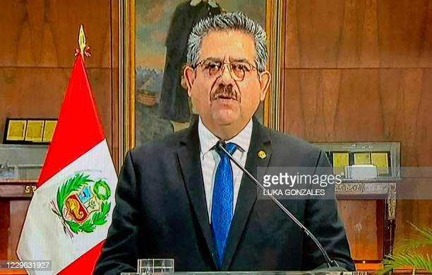 Grab taken as Peruvian interim president Manuel Merino announces his resignation in a televised message from the Government Palace, on November 15,...