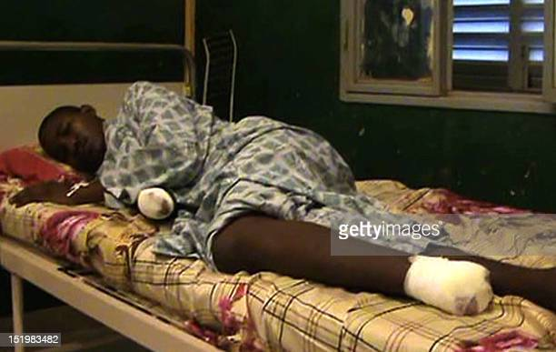 A grab taken from a video filmed on September 11 2012 shows a man lying on a bed in the Hangadoumbo Moulaye Toure hospital in Gao with his right hand...