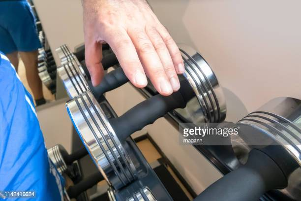 an image man grabbing dumbbell
