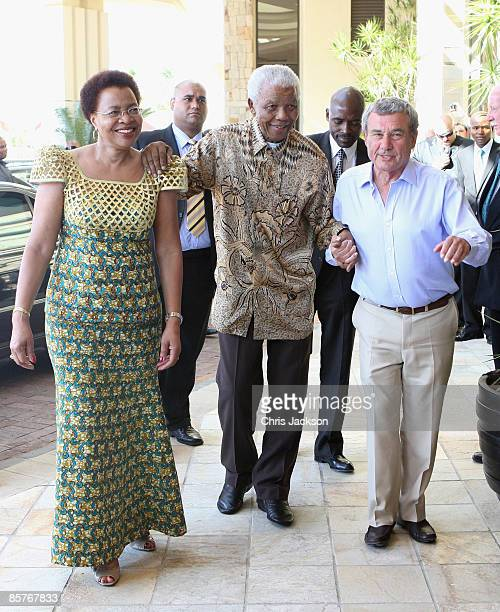 Graca Machel and Nelson Mandela greet Sol Kerzner as they arrive at the new OneOnly Cape Town resort on April 2 2009 in Cape Town South Africa Today...