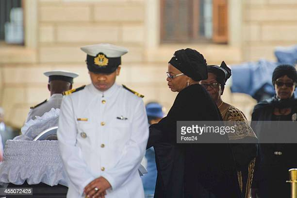 Graca Machel and Winnie Mandela with Madiba's body at the Union Buildings on December 11 2013 in Pretoria South Africa Former South African president...