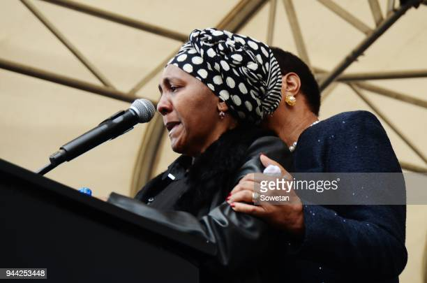 Graca Machel comforts Ndileka Mandela at Constitution Hill during a memorial service organized by the Nelson Mandela Foundation for Winnie...