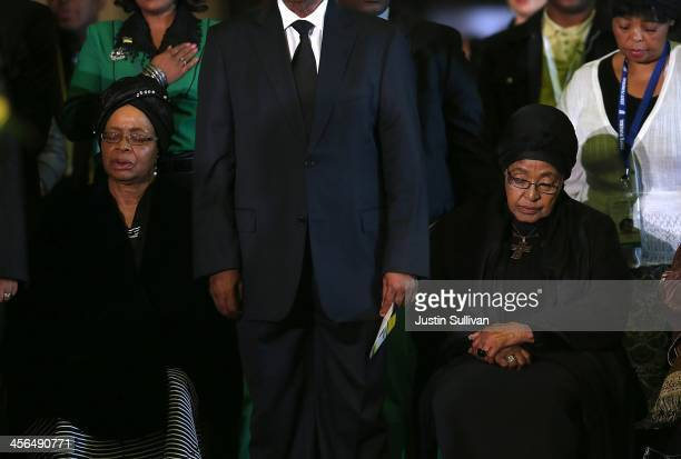 Graca Machel widow of Nelson Mandela and Winnie Mandela pray during an African National Congress led alliance send off ceremony for former South...