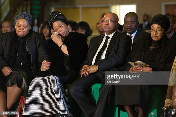 Graca Machel widow of Nelson Mandela South Africa's President Jacob Zuma and former wife of Nelson Mandela Winnie Mandela listen to speeches during...