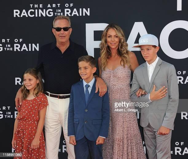 Grace Avery Costner Kevin Costner Hayes Logan Costner Christine Baumgartner and Cayden Wyatt Costner arrive for the Premiere Of 20th Century Fox's...