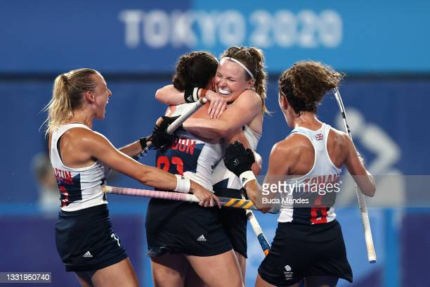 Grace Balsdon of Team Great Britain celebrates with teammates Hannah Martin, Hollie Pearne-Webb and Anna-Frances Toman after scoring their team's...