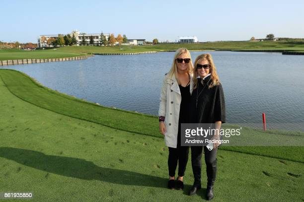 Grace Barber girlfriend of Thomas Bjorn Captain of Europe and Tabitha Furyk wife of Jim Furyk Captin of The United States pose for photos during the...