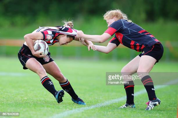 Grace Brooker of Canterbury pulls Serai MurrayWihongi of Counties Manukau over the sideline during the Farah Palmer Cup Premiership Final match...