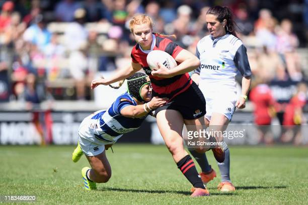 Grace Brooker of Canterbury runs through to score a try during the Farah Palmer Cup Final between Canterbury and Auckland at Rugby Park on October 26...