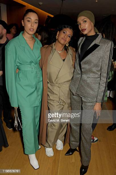 Grace Carter Neneh Cherry and Ikram Abdi Omar attend the Neneh Cherry and iD celebration of 30 years of 'Raw Like Sushi' at The London EDITION on...