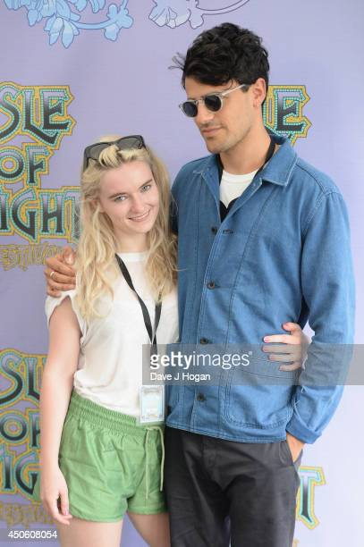 Grace Chatto and Milan Neil AminSmith of 'Clean Bandit' pose backstage at The Isle of Wight Festival at Seaclose Park on June 14 2014 in Newport Isle...