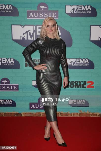 Grace Chatto of British electronic music group Clean Bandit poses on the red carpet arriving to attend the 2017 MTV Europe Music Awards at Wembley...