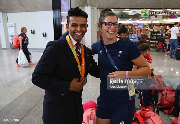 Grace Clough of the Paralympics GB Team shows her medal to a member of the British Airways cabin crew as they prepare to fly back from Galeao Airport...