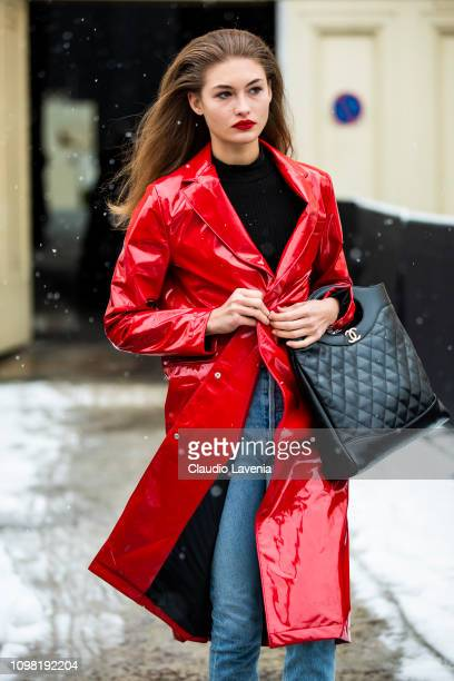 Grace Elizabeth, wearing a black sweater, blue jeans, black boots, black Chanel bag and red vinyl long jacket, is seen outside Chanel show during...