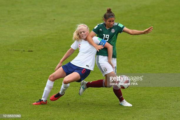 Grace Fisk of England challenges for the ball with Gabriela Juarez of Mexico during the group B match between England and Mexico at Stade de Marville...