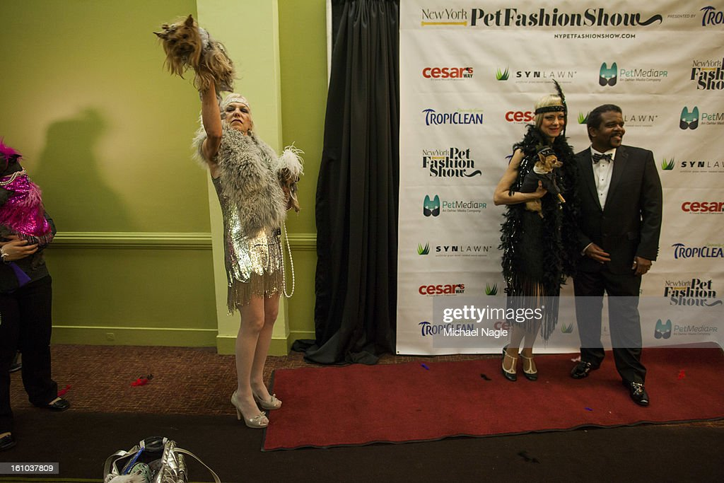 Grace Forster (L), Karen Biehl (M) and Richard Pryor, Jr. (R) at the New York Pet Fashion Show gather on the red carpet at Hotel Pennsylvania ahead of next week's Westminster Kennel Club Dog Show on February 08, 2013 in New York City. The Westminster Kennel Club Dog Show first held in 1877, is the second-longest continuously held sporting event in the U.S., second to the Kentucky Derby.