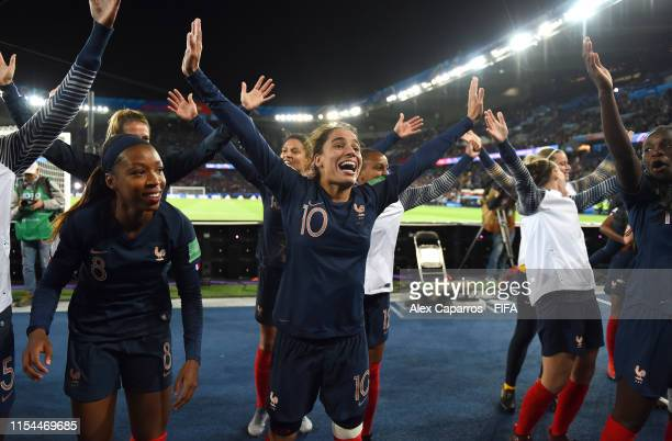 Grace Geyoro Amel Majri and Griedge Mbock Bathy of France celebrate with the fans following the 2019 FIFA Women's World Cup France group A match...