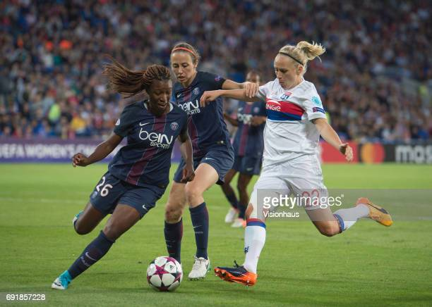 Grace Geyoro and Sabrina Delannoy of Paris Saint Germain combine to deny Pauline Bremer of Olympique Lyonnais during the UEFA Women's Champions...