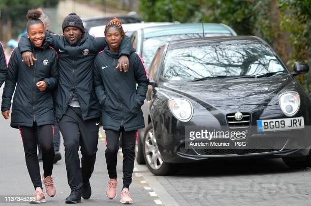 Grace Geyoro assistant coach Bernard Mendy and Aminata Diallo react during the Paris SaintGermain women prematch walk before the UEFA Women's...