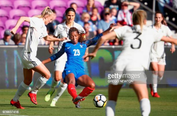 Grace Geyoro of France tries to clear the ball against Germany during their SheBelieves Cup soccer tournament match at Orlando City Stadium in...