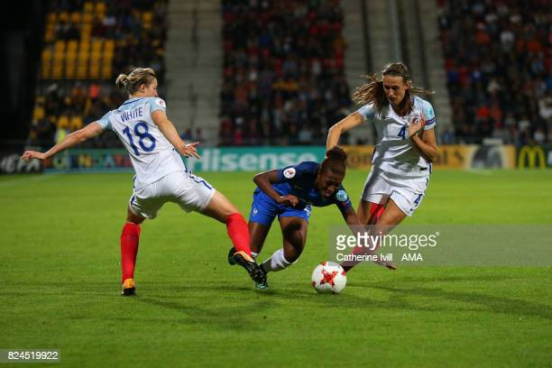 Grace Geyoro of France Women is tackled by Ellen White and Jill Scott of England Women during the UEFA Women's Euro 2017 match between England and...