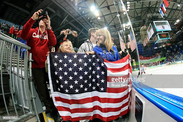Grace Ghiselli of San Francisco and Alexa Emery of Vancouver wait for the match between United States and China to start during their women's ice...