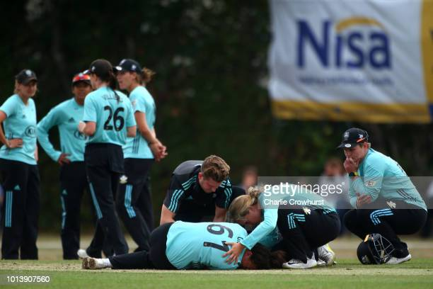 Grace Gibbs of Surrey lays injured as she in helped by team mate Sarah Taylor and club medic during the Kia Super League match between Surrey Stars...
