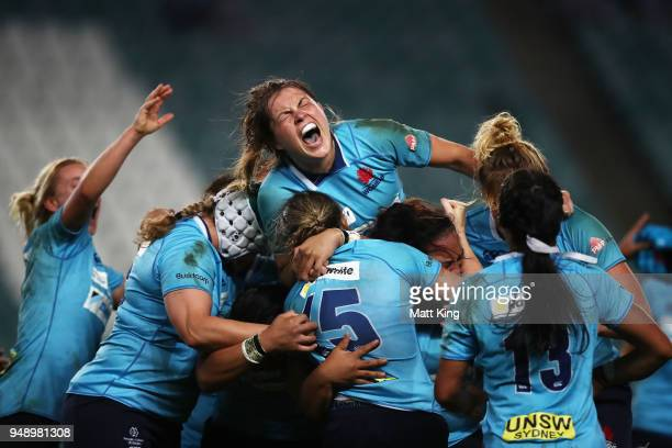 Grace Hamilton of New South Wales and team mates celebrate victory during the Super W Grand Final match between the the New South Wales Women and the...