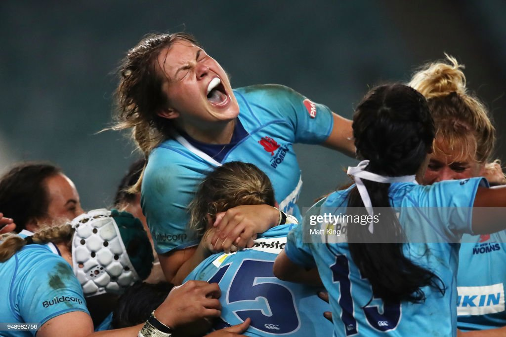 Grace Hamilton of New South Wales (top) and team mates celebrate victory during the Super W Grand Final match between the the New South Wales Women and the Queensland Women at Allianz Stadium on April 20, 2018 in Sydney, Australia.