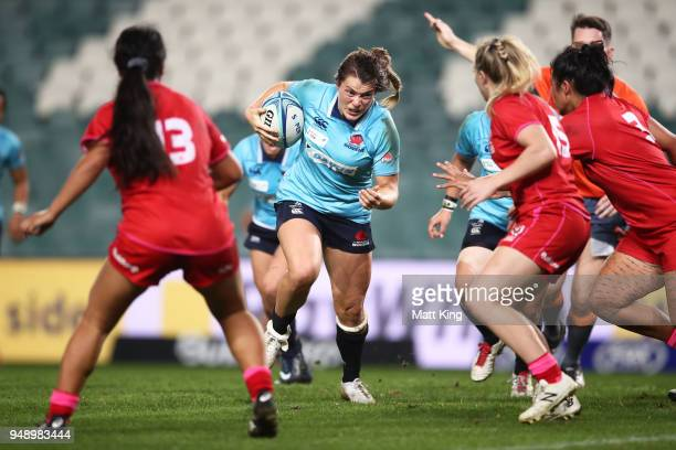 Grace Hamilton of New South Wales takes on the defence during the Super W Grand Final match between the the New South Wales Women and the Queensland...