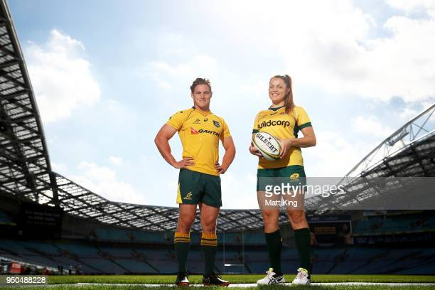 Grace Hamilton of the Wallaroos and Michael Hooper of the Wallabies pose during a Rugby Australia media call at ANZ Stadium on April 24 2018 in...