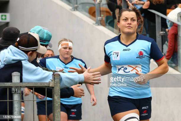Grace Hamilton of the Waratahs runs out during the Super W Final match between the NSW Waratahs and the Queensland Reds at Coffs Harbour...