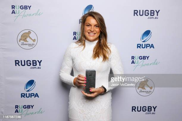 Grace Hamilton poses with The Buildcorp Wallaroo Player Of The Year during the 2019 Rugby Australia Awards at the Seymour Centre on November 14 2019...