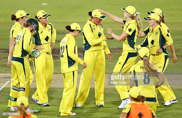 Grace Harris of Australia celebrates a wicket on debut with team mates during game one of the Women's ODI series between Australia and India at...