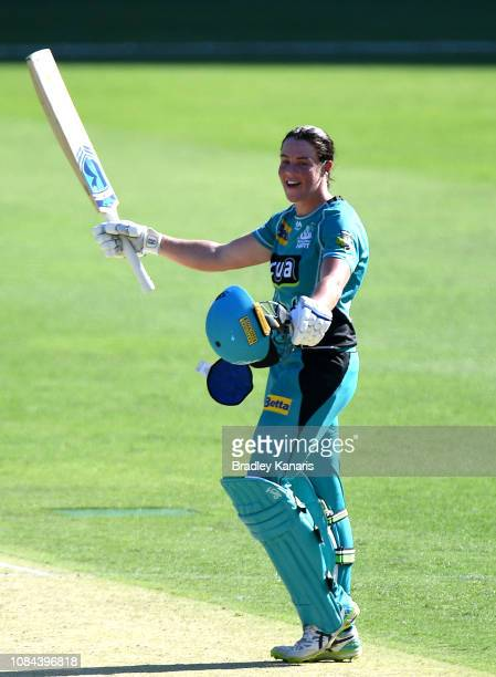 Grace Harris of the Heat celebrates scoring a century and victory during the Women's Big Bash League match between the Brisbane Heat and the...