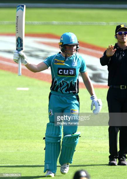 Grace Harris of the Heat celebrates scoring a half century during the Women's Big Bash League match between the Brisbane Heat and the Melbourne Stars...