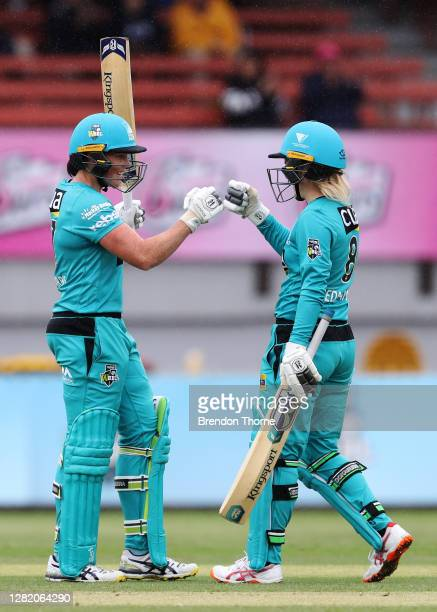 Grace Harris of the Heat celebrates scoring her half century with team mate Georgia Redmayne during the Women's Big Bash League match between the...