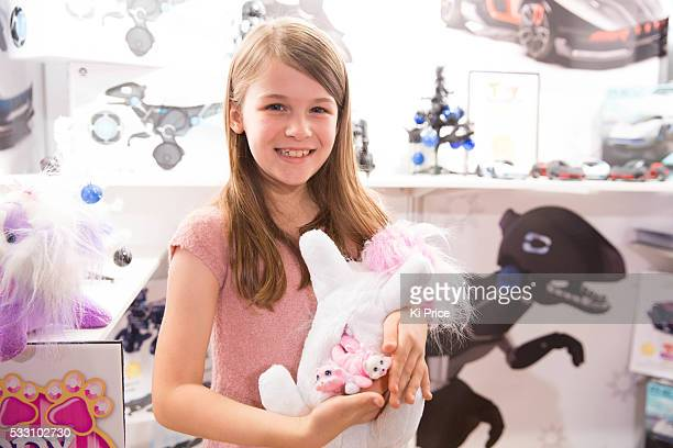 Grace Heaffey age 8 plays with Puppy Surprise at Dream toys 2015 Photos Ki Price