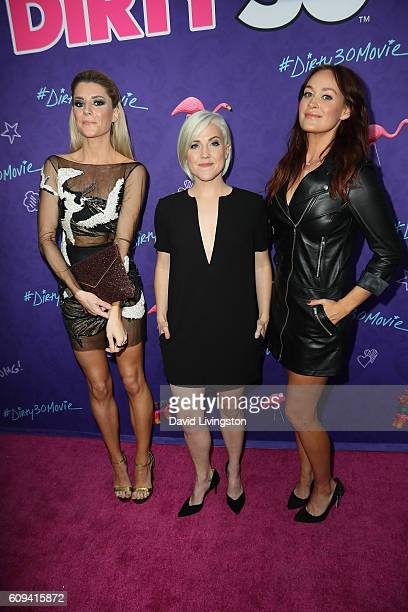 Grace Helbig Hannah Hart and Mamrie Hart arrive at the Premiere of Lionsgate's 'Dirty 30' at the ArcLight Hollywood on September 20 2016 in Hollywood...