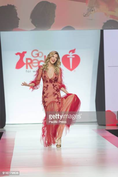 Grace Helbig wearing gown by Sachin Babi walks runway for Red Dress 2018 Collection Fashion Show at Hammerstein Ballroom