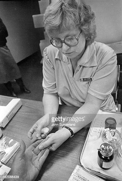 MAR 24 1981 MAR 29 1981 Grace Hooper of Greeley pricks finger of Robert Sterkel of Platteville for anemia and diabetes testing